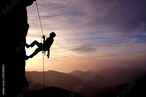 Poster Silhouette of Rock Climber at Sunset