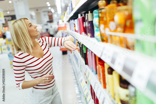 Beautiful woman buying body care products