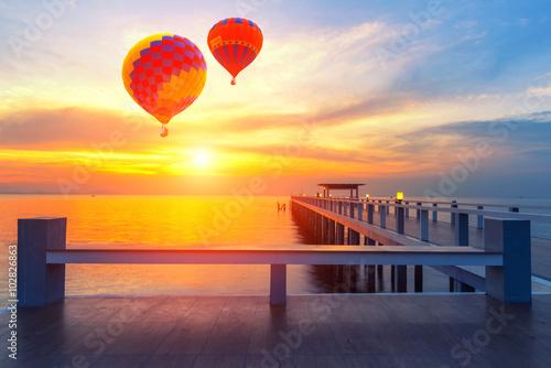 Deurstickers Ballon Colorful hot-air balloons flying over the sea