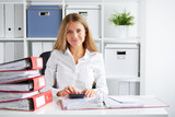 Business woman calculates tax