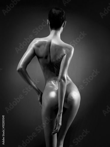 Poster Elegant nude model in the light colored spotlights