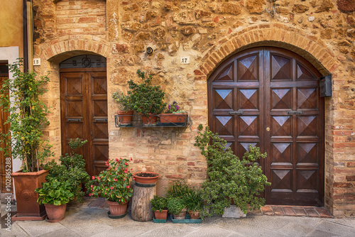 Fototapeta View of the ancient old european city. Street of Pienza, Italy with wooden doors.