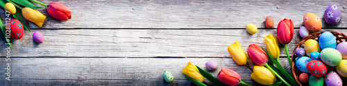 Tulips And Painted Eggs On Vintage Wooden Plank - Easter Background  Poster