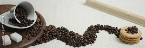 Coffee cup and coffee beans with cookies