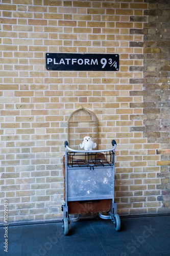 Kings Cross station wall visited by fans of Harry Potter to photograph sign for platform nine and three quarters with trolley