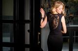 Woman in black dress looking over her shoulder