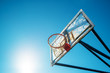 Plexiglass street basketball board with hoop on outdoor court