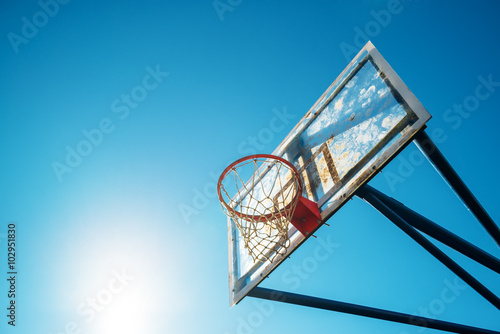 Poster Plexiglass street basketball board with hoop on outdoor court