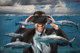Businessman Using Virtual Reality Glasses Seeing Sharks