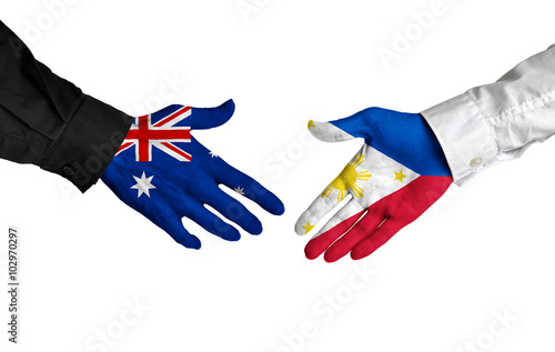 Poster Australia and Philippines leaders shaking hands on a deal agreement
