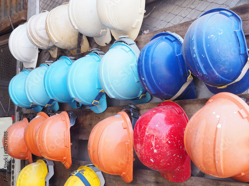old colorful construction helmets Poster