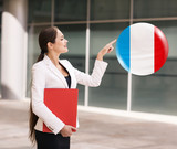 Woman point on the bubble with french flag
