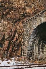 railway tunnel in the rock in the winter on a clear day