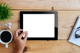 Fototapety hand using mockup tablet on wood desk white display with clippin