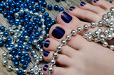 Beauty photo of nice blue pedicured feet