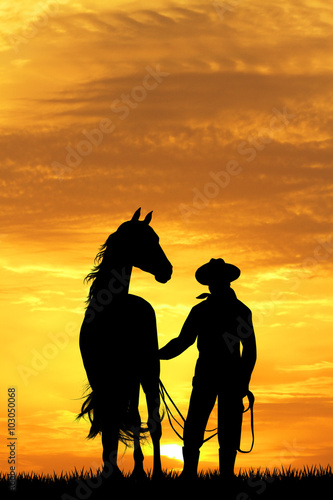 Poster cowboy with horse at sunset