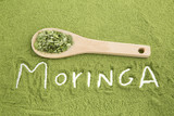 Moringa powder with wooden spoon