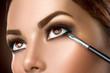 Woman applying makeup closeup. Eyeliner