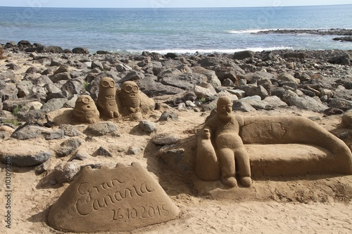 Poster Sand statue of funny cartoon characters
