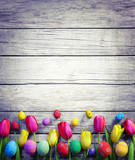 Fototapety Tulips And Easter Eggs On Vintage Wooden