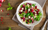 Fresh green salad with feta cheese and pomegranate.