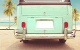 Fototapety Journey of holiday - Rear of vintage classic van parked side beach in summer