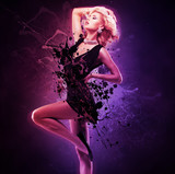 Beautiful girl dancer  in black dress in creative pose over art