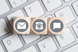 several contact options as icon on little cubes on a keyboard