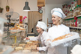 Woman offering fresh and pastry in bakery