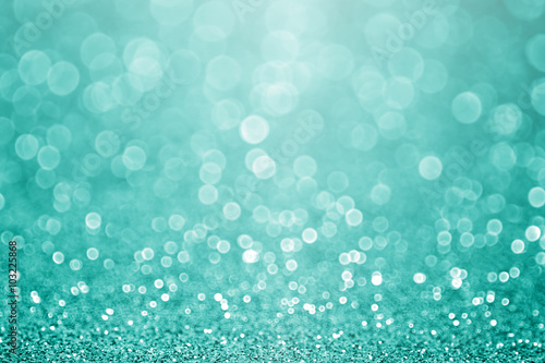Aqua turquoise and teal green bokeh glitter sparkle background