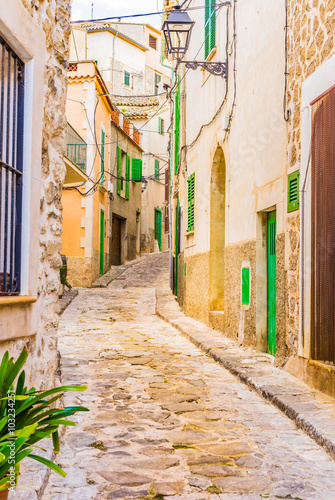 Fototapety, obrazy : Alleyway with old paving stones of an mediterranean village