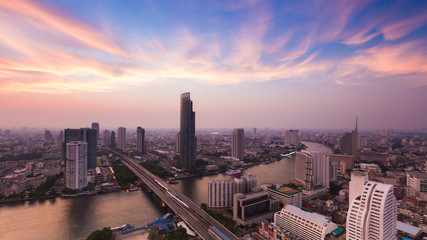 Dramatic sky after sunset over Bangkok river curved