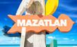 Mazatlan welcome sign with beach
