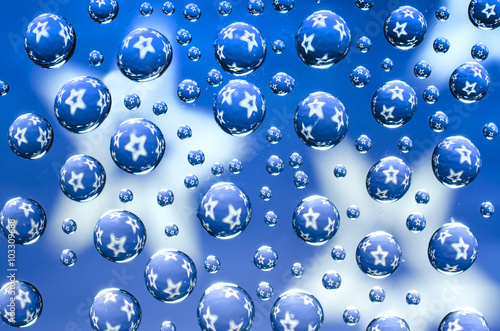 Water droplets with stars on a blue background © vitaly tiagunov