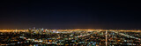 Fototapety Panorama long exposure night view of Los Angeles downtown and surrounding metropolitan area from Hollywood hills