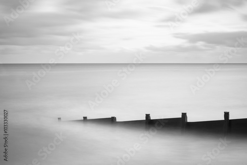 Fine art landscape image of long exposure sea in black and white