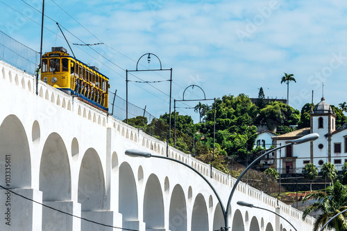 Yellow Train under the Lapa district in Rio de Janeiro, Brazil Poster