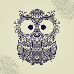 Patterned owl on the ornamental mandala background. African/indian/totem/tattoo design. It may be used for design of a t-shirt, bag, postcard, a poster and so on.