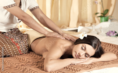 Fotobehang Spa Young woman getting massage in Thai spa.