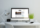 Fototapety modern clean workspace showing online news website