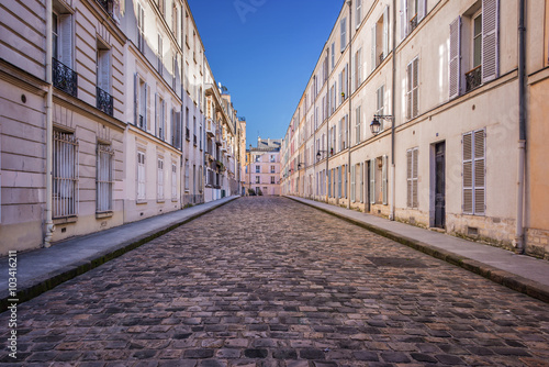 Picturesque cobbled street in Paris, France Poster