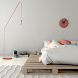 Fototapety Stylish bed on wooden pallets and pink décor