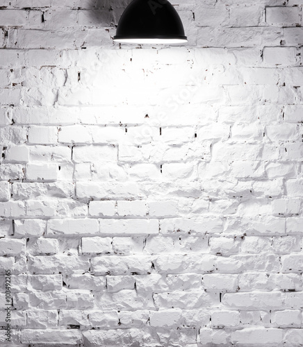 Naklejka texture of brick whitewashed wall with lamp on top
