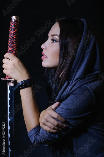 Anime stylized brunette with long hair holding a katana sword Poster