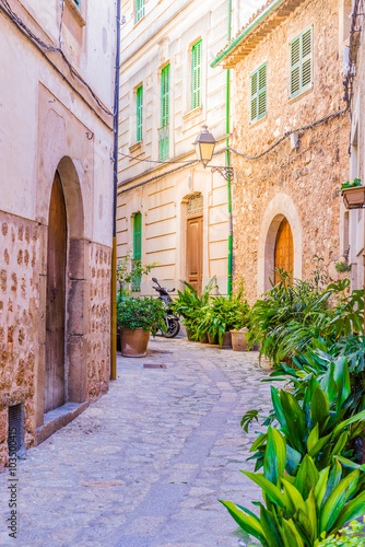 View of an beautiful narrow street with old mediterranean buildings