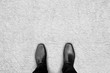 Black shoes standing on the carpet