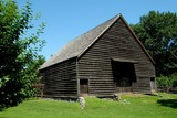 Sleepy Hollow, NY - July 9, 2009:  The wooden exterior of old Dutch barn at historic c. 1750 Philipsburg Manor