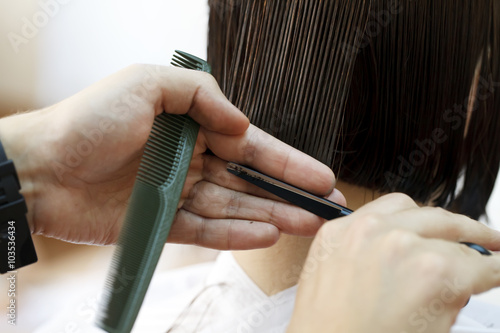 stylist hairdresser doing haircut Slika na platnu