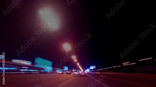 Foto op Aluminium Nacht snelweg Fast speed driving at night in an urban city setting. Dubai time lapse video.
