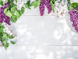 Blooming lilac flowers on the old wooden table. - 103563011